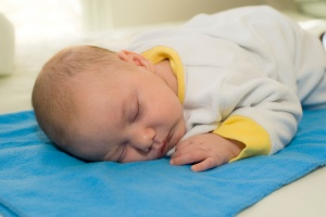 BYXR1A Sleeping baby boy with window light. Parent model released